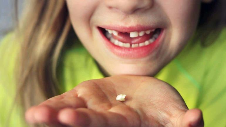 Увидеть вырванный зуб